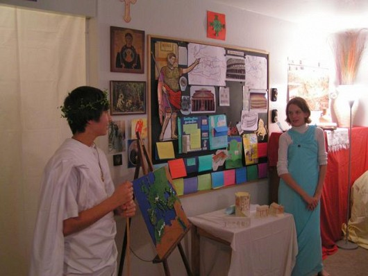 Older Students Giving Class on Roman History
