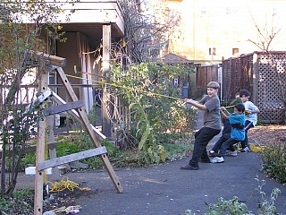 Using a Pulley System to Remove Old Fence Posts